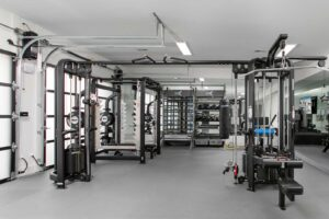 garage home gym designed for family fitness, functional training, strength and power lifting, and akitv recovery