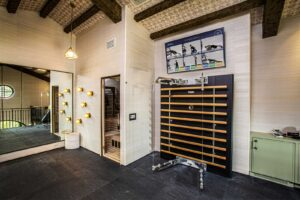 home gym located in loft space with Technogym kinesis and Aktiv TV for guided workouts