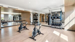 RXR Village Square Fitness Center with Gym Rax Suspension training bays, spin bikes and gym flooring