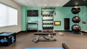 Hilton Tru Hotel Fitness Center gym design by Aktiv with gym rax, aktiv tv, gym flooring, and functional training equipment