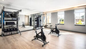 Rxr village square fitness center with gym rax, spin bike, gym flooring for functional training