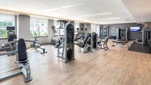 Rxr village square fitness amenity gym design with nautilus strength fitness equipment, gym flooring, and gym rax